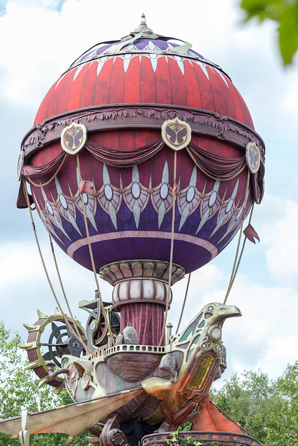 Giant gold-purple inflatable airship forming a bird at Tomorrowland festival, Belgium