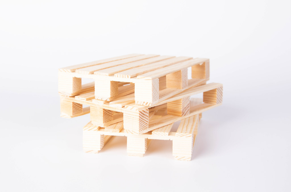 Wooden pallets on white background   ✅ Marco Verch is a