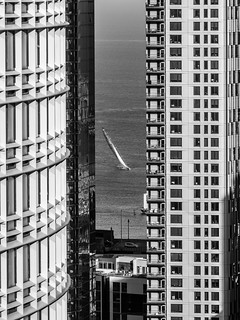 Oracle's 2003 America's Cup contender, USA 76, slicing through San Francisco skyscrapers