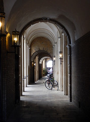 Bikes beneath an arched colonnade in Copenhagen, Denmark
