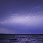 20. Juuli 2019 - 0:39 - Lightning seen east of Oshkosh, WI out over the east shore of Lake Winnebago. The red lights at lower right are windmills.  July 20, 2019.   Copyright All my photographic and video images are copyrighted. All rights are reserved. Please do not use, copy or edit any of my photographs without my written permission. If you want to use my photo for commercial or private use, please contact me. Please do not re-upload my photos at any location on the internet without my written consent.