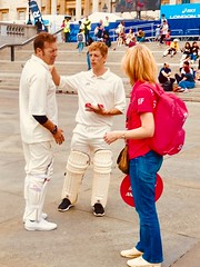 Two cricketers, one ball and a cricket bat...