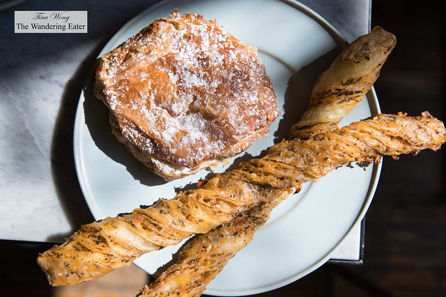 Chocolate almond croissant and two savory cheese and fennel bread sticks