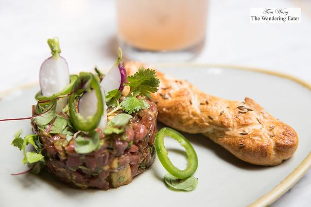 Beef tartare, watermelon, coriander, bonito,shallot, Tabasco and a side of house made fennel bread stick