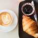 Croissant and housemade blueberry mint jam, capuccino