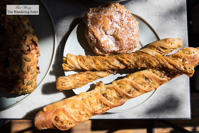 Onion and cheese bread, duo of cheese and fennel bread sticks, chocolate almond croissant, pumpkin seed cranberry bread