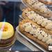 Lemon tart with sea buckthorn berries and chocolate eclairs