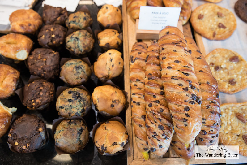 Breakfast pastries of muffins, chocolate chip viennoiserie and cookies