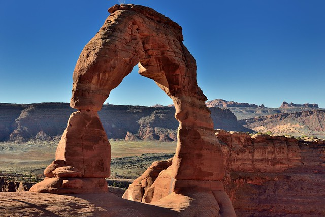 Mesa, Buttes, and Blues Skies as a Backdrop for the Delicate Arch (Arches National Park)
