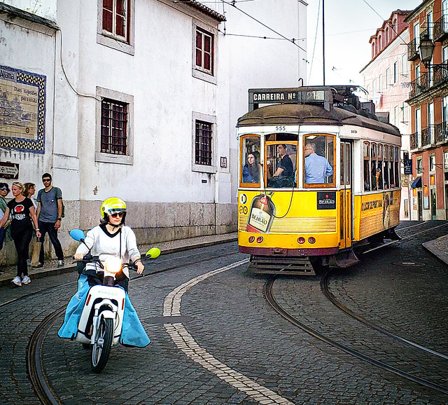 Scooter and Tram 28 in Lisbon