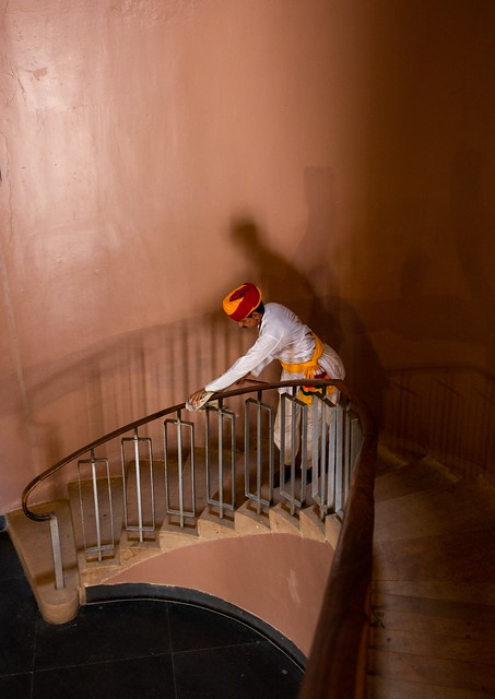 Man cleaning a stair in Jodhpur fort India