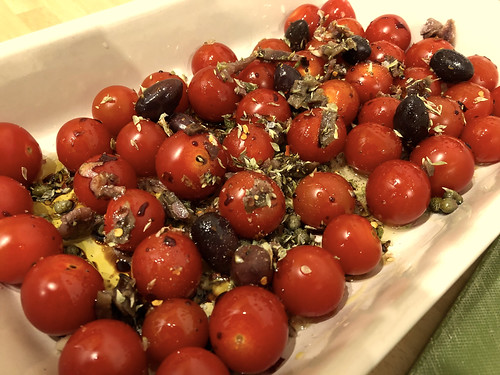 Uncooked tomatoes in a baking dish