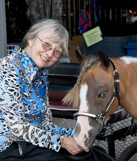 Mary Adams with Jake, a miniature horse.