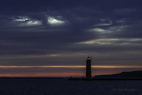 sunset monet lighthouse michiganlighthouse muskegon