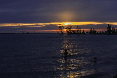 swimmers swimming lakemichigan sunset muskegon