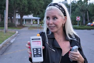 Tracey Rieker Holds a Mel Meter, Commonly Used in Paranormal Investigations, During a Venice Ghost Walk with Venice Florida Tours, April 2019 | by JenniferHuber