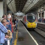 People and train at Preston Railway Station