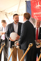 Rep. Davis speaks with Gov. Lamont during a ground breaking ceremony for the new Bradley International Airport Ground Transportation Center