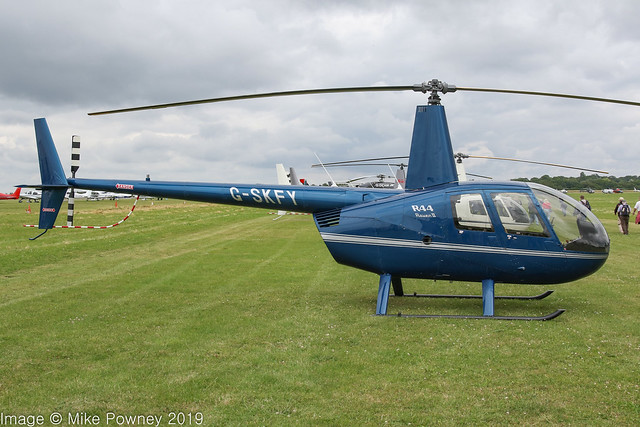 G-SKFY - 2013 build Robinson R44 Raven II, at Turweston during the 2019 British Grand Prix at nearby Silverstone