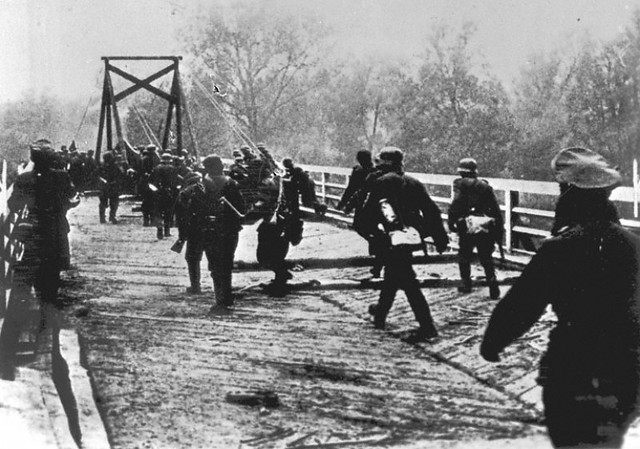German soldiers crossing the border river