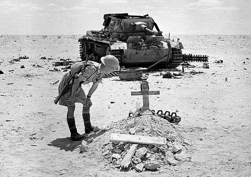 British Army soldier at the grave of a dead German tanker near a destroyed Panzer Pz.Kpfw  III in the desert in Egypt September 1942.
