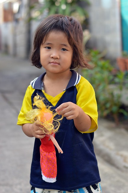 girl with her yellow haired doll