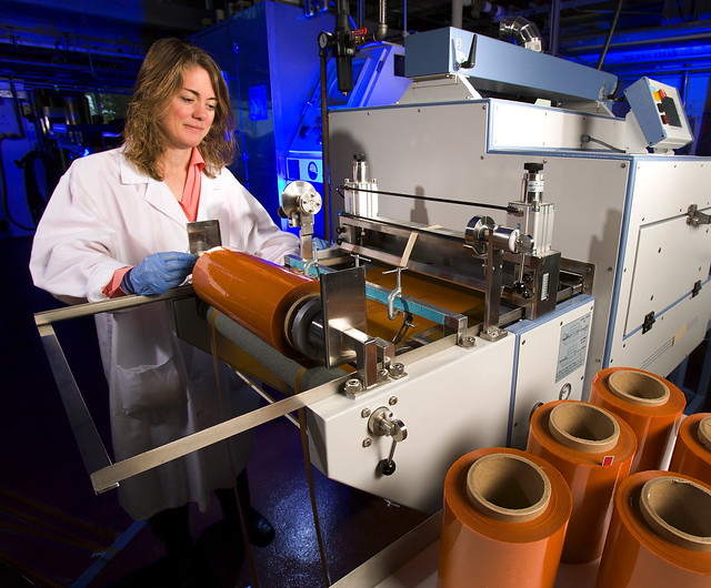 Tara McHugh casting carrot wrap into rolls at ARS's Western Regional Research Center