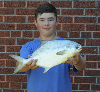 Photo of young angler with 3.375 lb. Florida pompano. a state record for the Chesapeake Division of state records