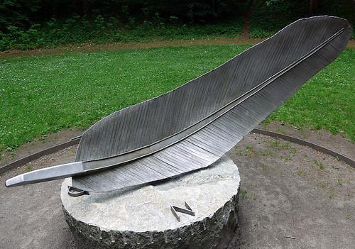 Weather vane with a metal feather sculpture at the Sculpture Park (KunstCentret Silkeborg Bad) in Silkeborg, Denmark