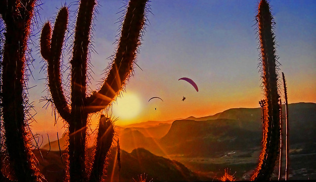 Two paragliding at sunset