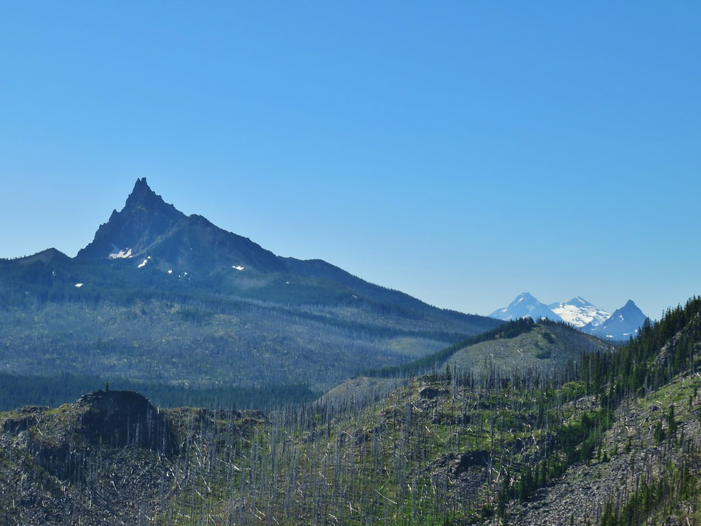Three Fingered Jack with Three Sisters and Mt. Washington beyond Red Butte