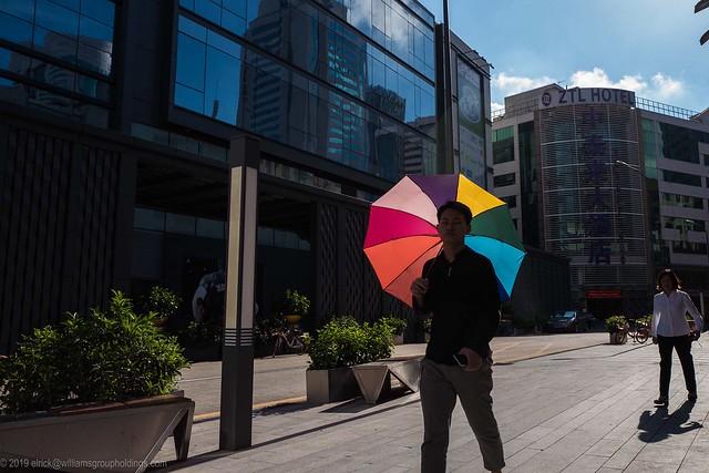 Rainbow Umbrella and Blue Sky