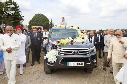 Satguru Mata Ji on a flower bedecked open car