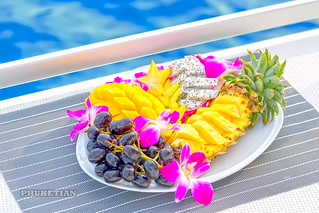 Fruit plate with pineapple, mango, grapes and dragon fruit (pitaya or pitahaya) on the sailing yacht in Thailand between Phuket and Phi Phi island     XOKA3510b4s