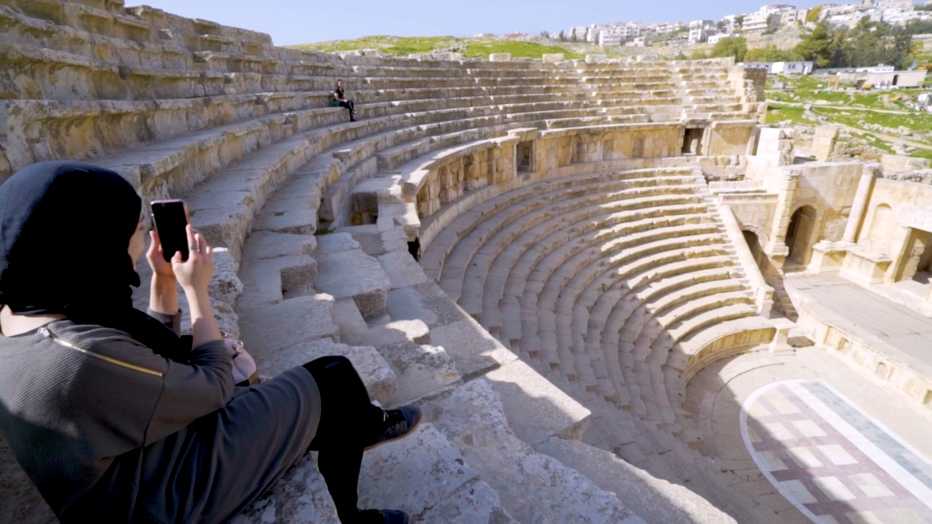 A student sitting in an amphitheatre