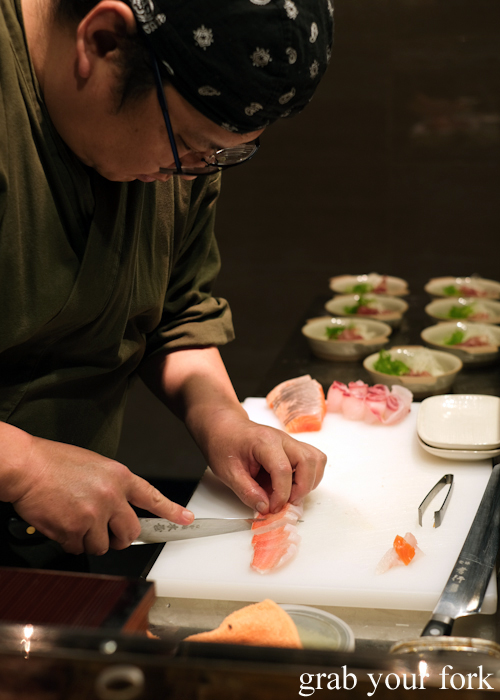Chef Hideaki Fukada slicing imperador sashimi for our omakase at Jizakana in Cammeray, Sydney
