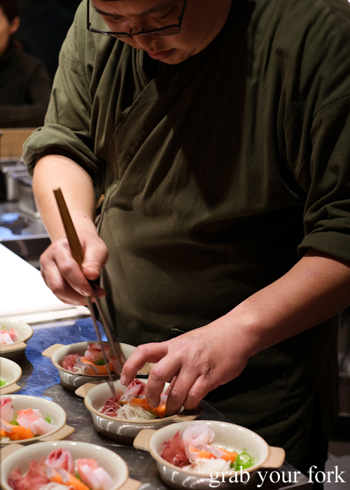Chef Hideaki Fukada assembling our sashimi bowls for our omakase at Jizakana in Cammeray, Sydney