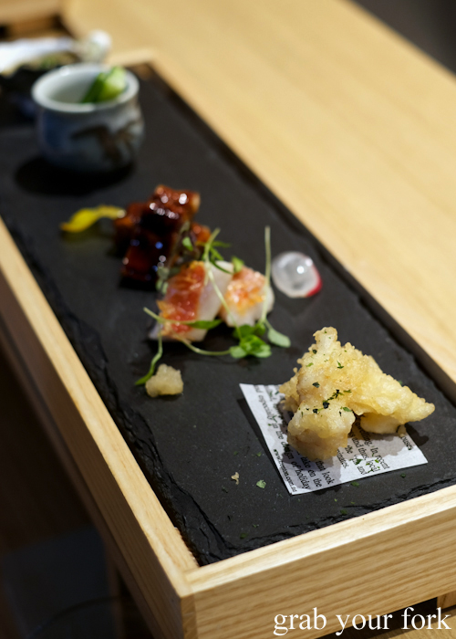 Cuttlefish tempura, seared imperador, unagi eel, kani miso with cucumber and raw oyster appetisers during our omakase at Jizakana in Cammeray, Sydney