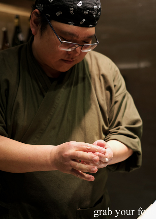 Chef Hideaki Fukada shaping nigiri sushi for our omakase at Jizakana in Cammeray, Sydney