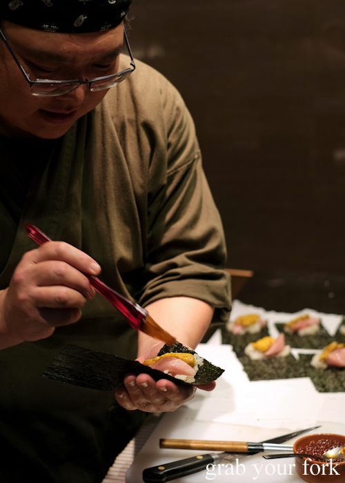 Chef Hideaki Fukada brushing the ootoro tuna belly with soy sauce for our omakase at Jizakana in Cammeray, Sydney