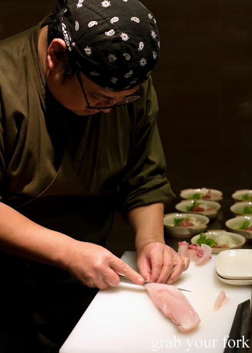 Chef Hideaki Fukada slicing kingfish sashimi for our omakase at Jizakana in Cammeray, Sydney