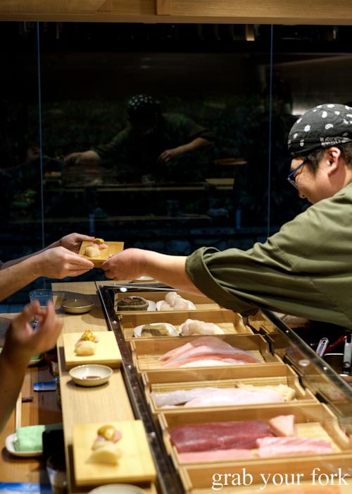Chef Hideaki Fukada serving our ootoro tuna belly and uni sea urchin roe nigiri sushi during our omakase at Jizakana in Cammeray, Sydney