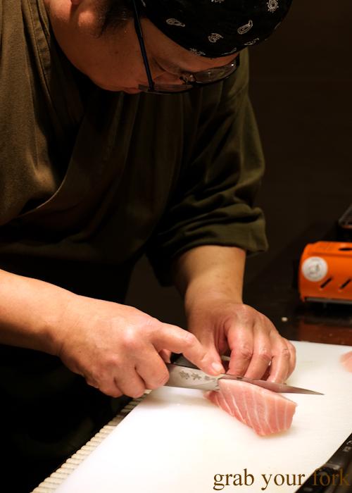 Chef Hideaki Fukada slicing the jabara ootoro tuna upper belly for our omakase at Jizakana in Cammeray, Sydney