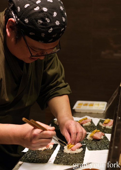 Chef Hideaki Fukada making temaki handroll sushi with ootoro and uni sea urchin roe for our omakase at Jizakana in Cammeray, Sydney