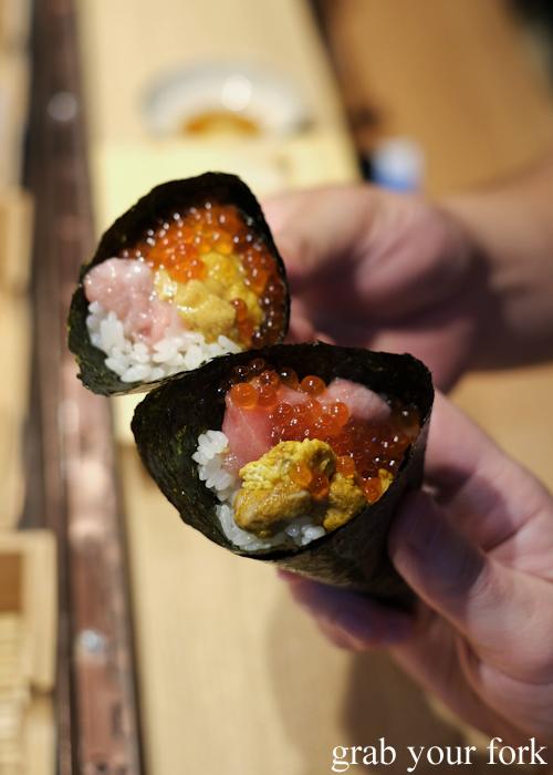 Temaki handroll sushi with ootoro tuna belly, uni sea urchin roe and ikura samon roe at Jizakana in Cammeray, Sydney