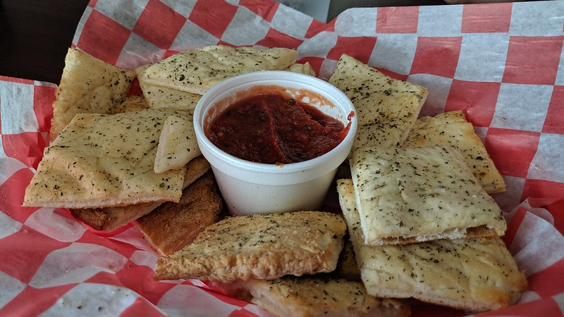 Garlic Butter/Parmesan Breadsticks (Oven baked dough lightly buttered, topped with garlic and parmesan. Served with marinara sauce.) $3.99
