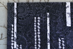 Quilting detail on black and white quilt