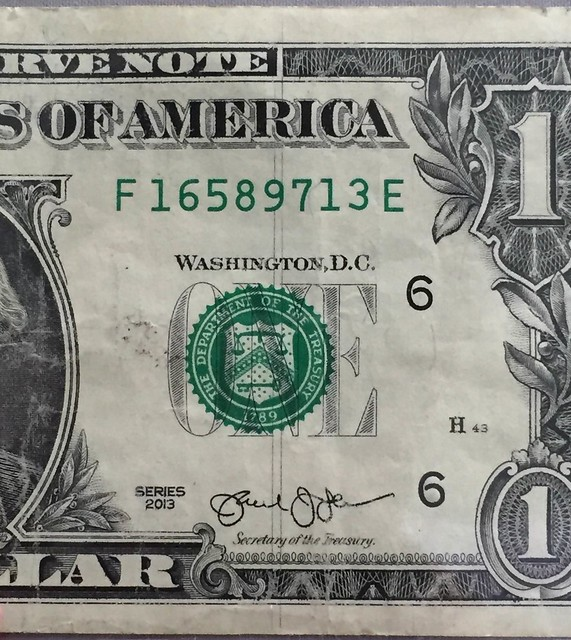 Dollar bill with vertical lines closeup