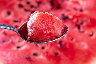 Close-up of spoon with a piece of red watermelon | by wuestenigel