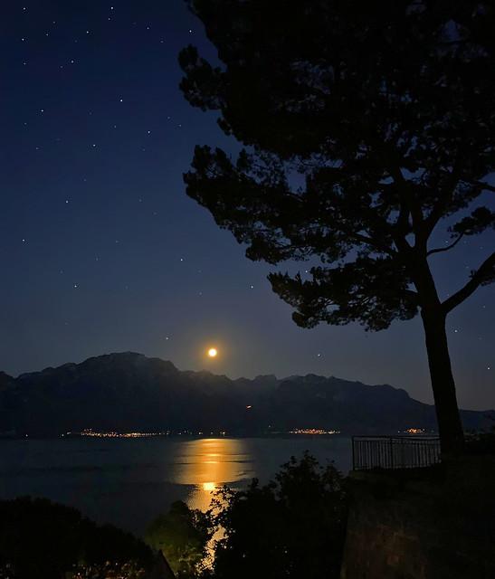 Moonset behind French Alps and Leman lake